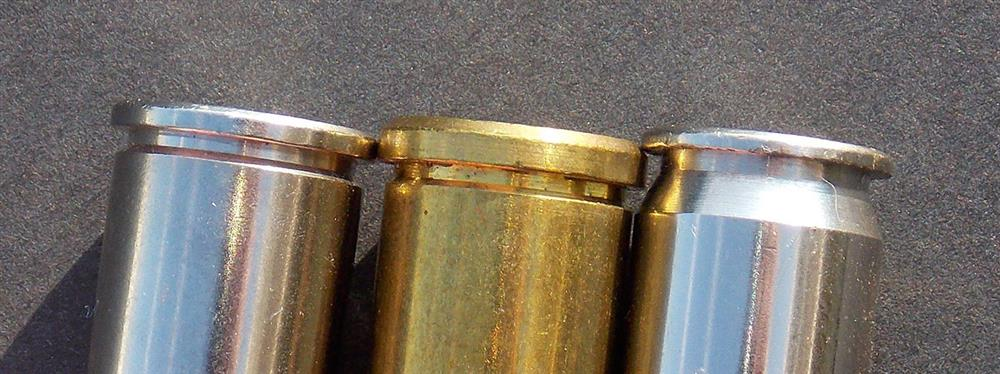 Closeup of three .45 caliber cartridges showing the differences in each