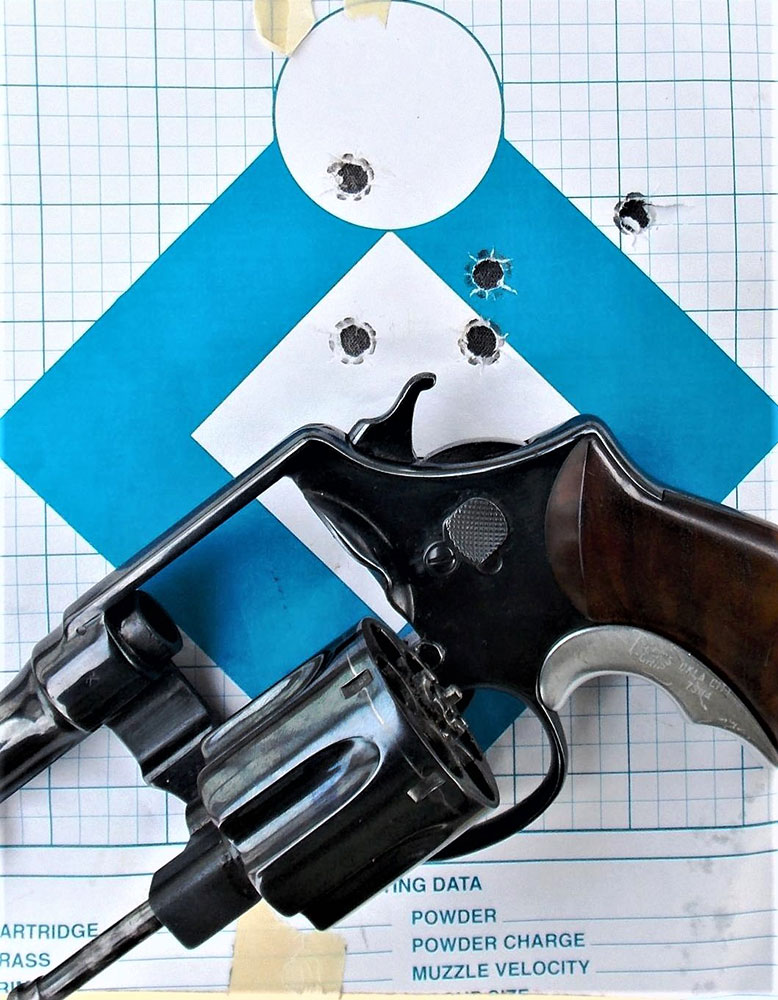 .45 ACP rexolver on a blue and white paper target