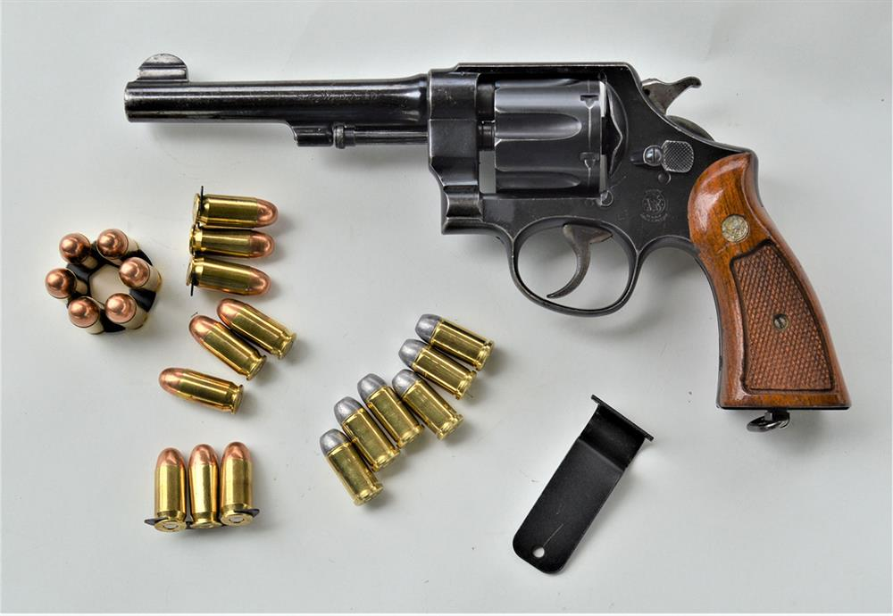 Smith and Wesson revolver chambered in .45 and shown with .45 ACP and .45 Auto Rim ammunition
