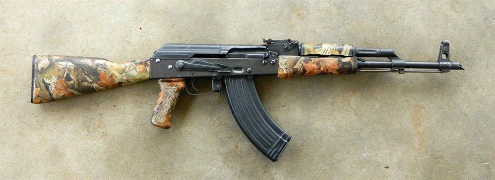 AK-47 rifle with camouflage furniture