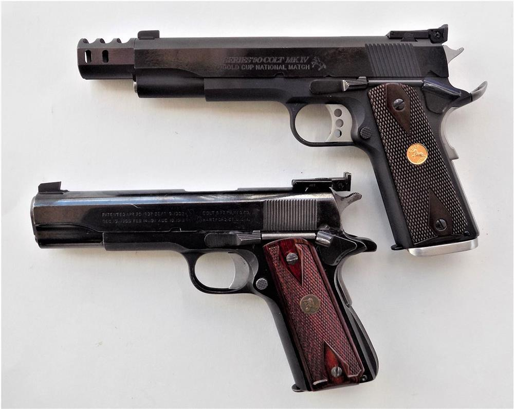 Colt 1911 pistol with compensator, top and Colt 1911 Bullseye gun customized by Madore, bottom