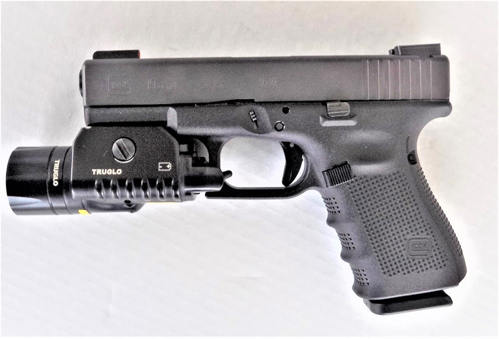 Glock 19 left profile with TruGlo combat light