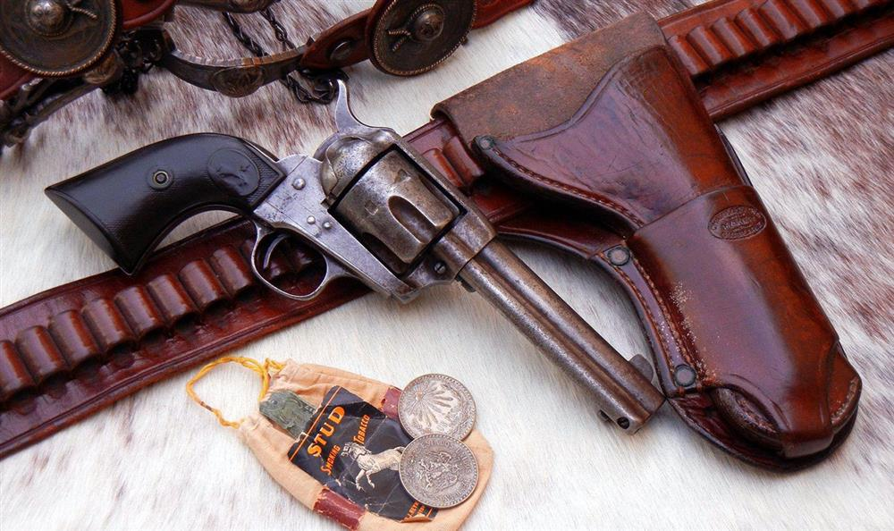 Old Colt Single Action Army revolver with original Collins holster