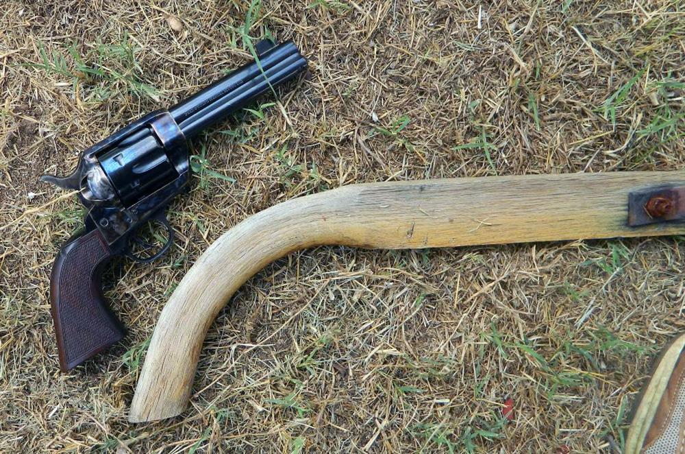 Traditions reproduction revolver measured against a plow handle to show grip similarity