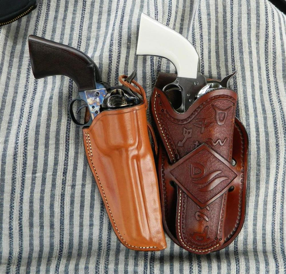 Two traditional leather holsters for cowboy action revolvers