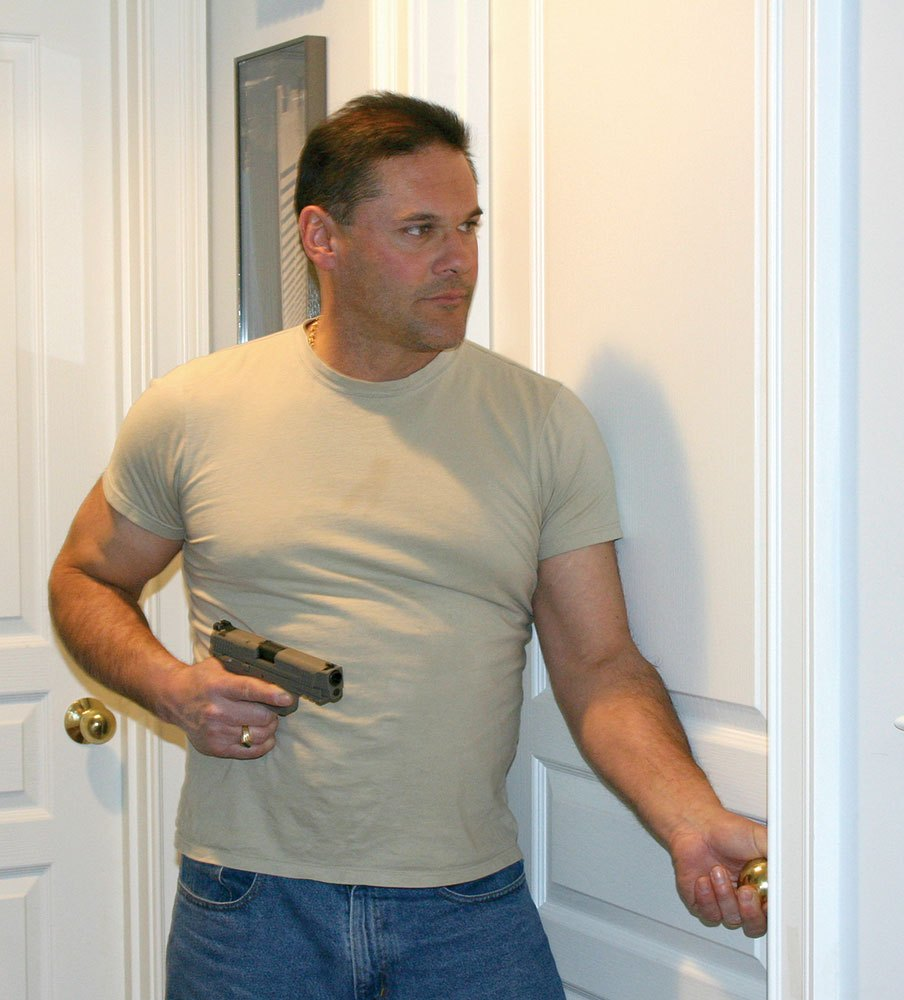 Opening a door with one hand while holding a handgun in the other