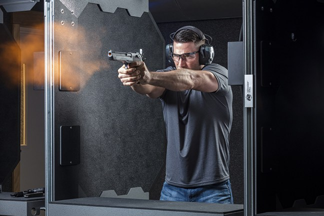 Shooting a pistol showing a fireball coming from the muzzle