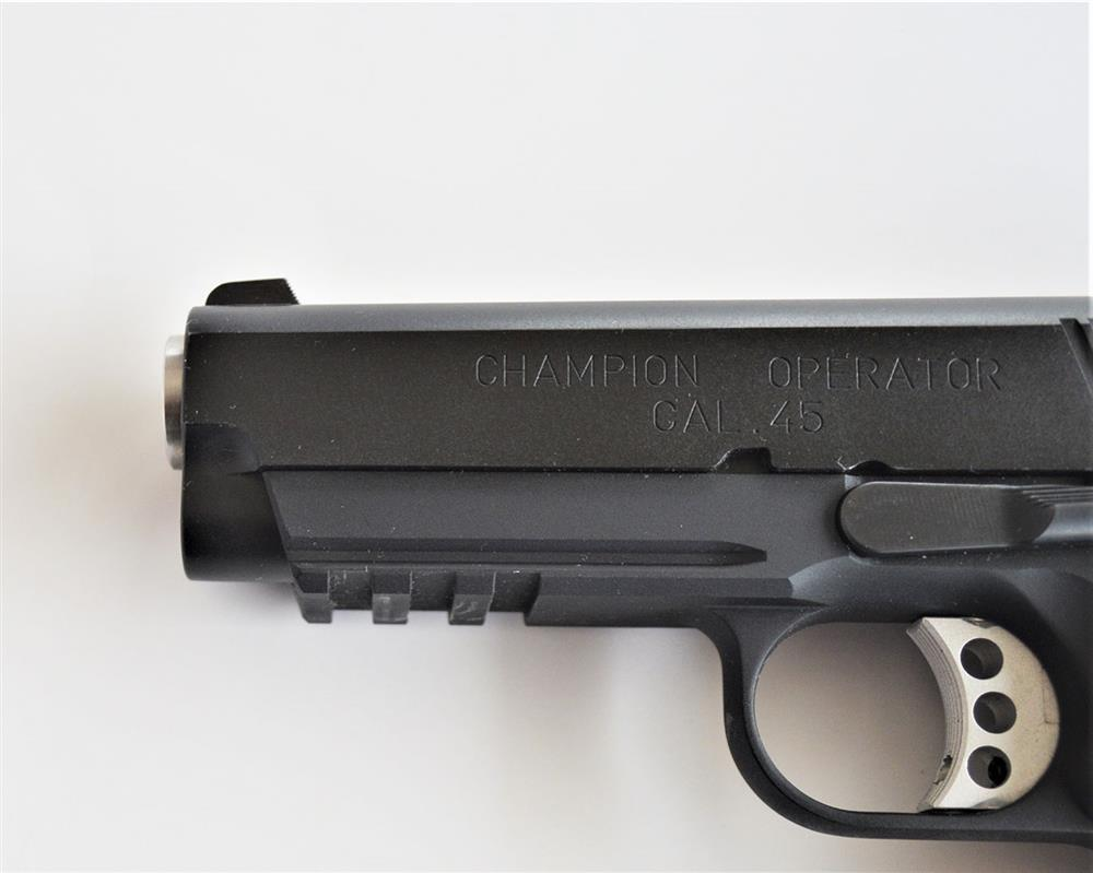 handgun dust cover with Picatinny rail which could be a problem for holsterless carry