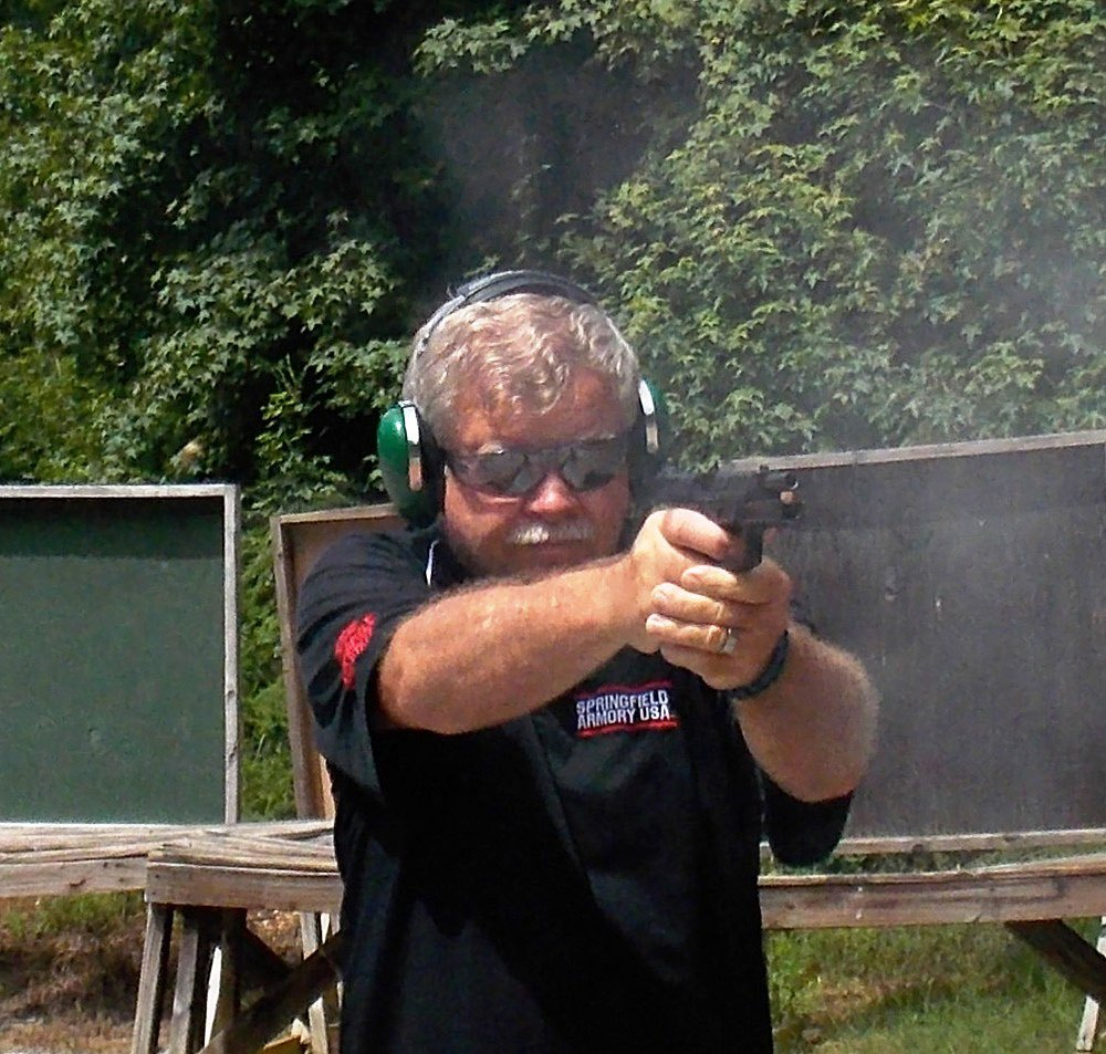 Bob Campbell shooting a pistol loaded with lead bullets