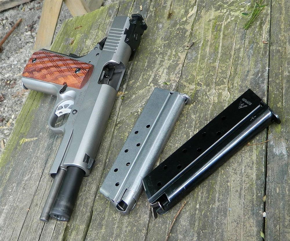 Ruger SR1911 10mm pistol with two Ruger and one Mecgar magazines