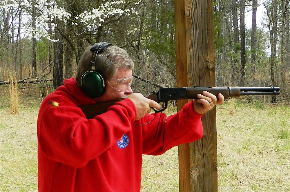 Bob Campbell shooting the Rossi Frontier rifle with an ejected case in the air